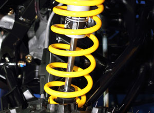 Yellow suspension coil fitted to vehicle